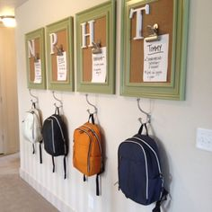 Backpack hooks with framed cork boards above them. One for each child.