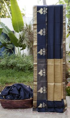 This indigo coloured sari is a chanderi silk. The border has a band of gold tissue and bhuttas made with gold zari all along, while the pallu has gold tissue and indigo making it just right for the...