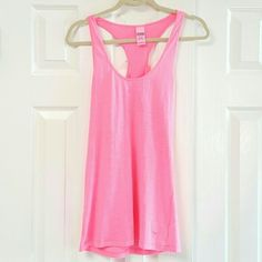 Pink by Victoria Secret Racer Back .Very clean pink top    60% cotton 40% polyester stitching intact no stains or rips  very gently used PINK Victoria's Secret Tops Tank Tops