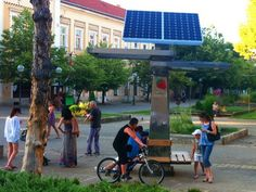 """Strawberry Energy """"trees"""" offer free public solar charging for gadgets."""