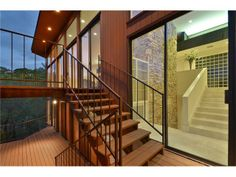 Hard wood outdoor staircase wonderfully compliments a marble interior stair case at 607 Cutlass, Lakeway Property Listing: MLS® # 3527848