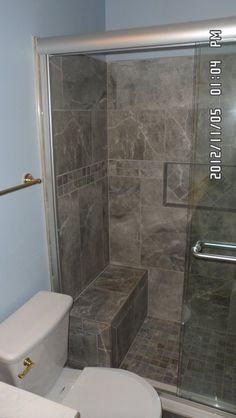 Tile Shower & Tile Floor...i like the idea of a seat in there too.