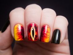 Eye of Sauron Nails...  These nails are a little darker, perfect for summer evening BBQ's, because they both have one thing in common, lots of fire! I really like the way the colours have so much depth in this design, it really is a show stopping pattern for your nails! Do the right thing, and paint your nails like this at least once this summer, you won't regret it. Perhaps accessorise with a ring, but just one ring, y'know.