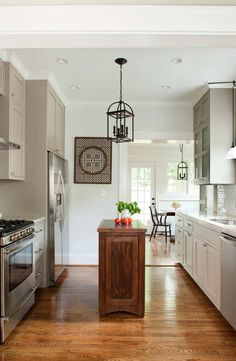 Photo by: Jeff Herr  Designed by: TerraCotta Properties  (Gray cabinets, subway tile, narrow kitchen island)