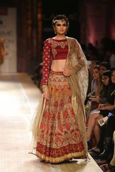 Maroon and gold Indian wedding lehnga with long sleeved short blouse by Anju Modi at Lakme Fashion Week Winter 2014. More here: http://www.indianweddingsite.com/lakme-fashion-week-winter-2014-anju-modi-collection/