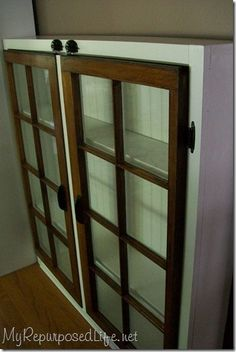 Old window frames recycled into an amazing glass front built in cabinet.....