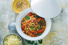 Butternut Squash Tagine with Chickpeas: Reimagine butternut squash with savory spices, tomatoes, and raisins in this delicious Moroccan-inspired dish. Gourmet Recipes, Vegetarian Recipes, Healthy Recipes, Chickpea Recipes, Healthy Food, Tagine Recipes, Ras El Hanout, Easy Cooking, Butternut Squash