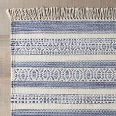 Inspired by handwoven traditions, Santiago dresses the floor with intricate navy and white patternwork.