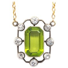 1900s Antique Peridot Diamond Silver Gold Necklace | From a unique collection of vintage drop necklaces at https://www.1stdibs.com/jewelry/necklaces/drop-necklaces/