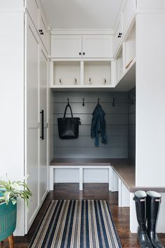 Small l-shaped mudroom bench features black shiplap trim and white upper cubbies under cabinets with oil rubbed bronze knobs. Mudroom Cubbies, Mudroom Cabinets, Mudroom Laundry Room, Bench Mudroom, Shiplap Trim, White Shiplap Wall, Small Mudroom Ideas, Entryway Ideas, Built In Bench