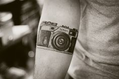 Camera tattoo! (Roland's first) - Wouldn't mind a world map tattoo, with a small version of the camera somewhere near it!