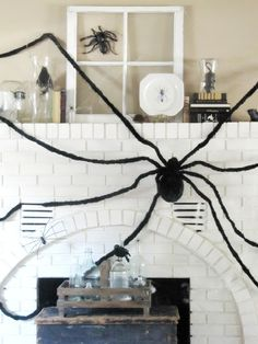 Top 10 Halloween Mantel Ideas - I love every single one especially this huge spider!  eclecticallyvintage.com