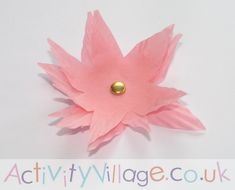Three cupcake papers and a paper fastener make a pretty pink (or yellow) flower