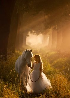 Girl child and white horse