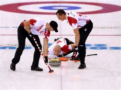 DAY 10:  (L-R) Ryan Fry, E.J Harnden and Ryan Harnden of Canada compete during the Curling Men's Round Robin Session 10 - Canada vs. USA