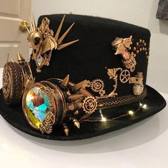 For all you steampunk lovers - this hat will make you stand out like no other! One of a kind design that took over 30 hours to make and details that will blow ur mind . Most of the embellishments are hand sewn for extra durability .