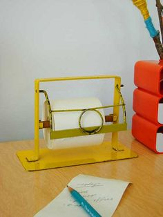 vintage paper holder-need some of these for my huge rolls of paper!