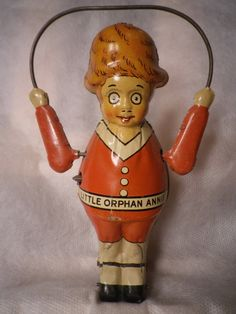 "Vintage ""Little Orphan Annie"" tin litho wind up toy."