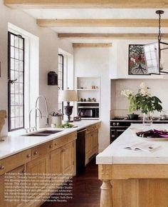 Marble counters, limed oak cabs, Benjamin Moore's French canvas on plaster walls, Dornbracht faucet, La Cornue range by belinda