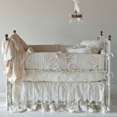 the more I look at cribs and bedding, the more I want an old crib like this. <3