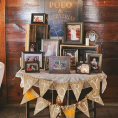 """""""Story of Us"""" table filled with framed photos of the couple along with their parents and grandparents."""