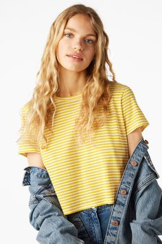 A super soft cropped tee with a hem that's a bit shorter in the front, longer in the back. Killer with your fav pair of high waisted denim.