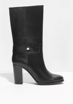 Straight shaft and fine detailing bring modern sophistication to these mid-calf leather boots elevated by contrasting block heels.