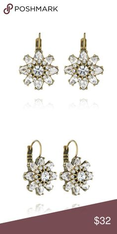 "Chloe + Isabel Mirabelle Drop Earrings Abstract florals + modern facets take shape in these look-of-luxe drop earrings. Set within antique gold-plating, high-shine clear crystals add the perfect touch of drama + sparkle to any look. •antique gold-plated •nickel-free plating •0.75"" approx. width •lever back •clear crystal Chloe + Isabel Jewelry Earrings"