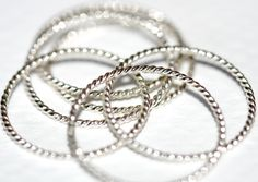 A set of 8 sterling silver stack rings 6 rope/twist by Eklektisch