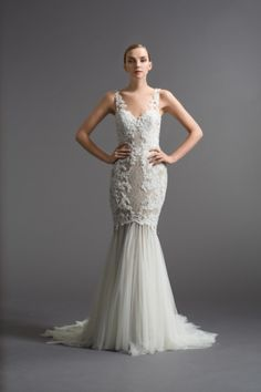 This stunning lace and tulle dress from Watters: http://www.stylemepretty.com/2014/11/03/21-of-our-favorite-lace-dresses/