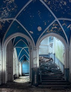 The entrance hall of a forgotten château in southern Belgium. Emmett had to evade an irascible local groundskeeper known for circling the property on his bicycle with a small shotgun at his side.