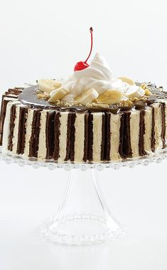 Banana Split Cake: Festive ice cream cakes are always a summer favorite. Our version duplicates the flavor of a banana split made with strawberry ice cream-with the added twist of ice cream sandwiches. Topped with gooey hot fudge, whipped cream, nuts, and a cherry (if you like), this is a cake you'll go bananas for. Frozen Desserts, Frozen Treats, Banana Split Ice Cream, Cake Recipes, Dessert Recipes, Swiss Rolls, American Cake, Tea Time Snacks, Hot Fudge