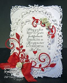 For this card I used white and real red and layered up Spellbinders Labels 8, Decorative Labels 8, and Floral Ovals. I also decorated with Cheery Lynn Fanciful Flourish Small. The little white roses are ZVA Creative. The ribbon is May Arts.