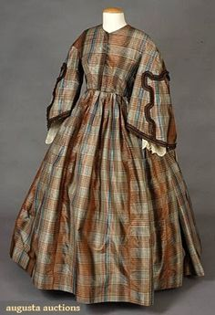 "PLAID SILK TAFFETA DAY DRESS, 1850s 1-piece, brown, blue, red & green, chocolate brown silk trim & velvet ribbon, huge pagoda sleeves w/ lace undersleeves, B 35"", W 28"", L 53"", Sh-Sh 18"", (few small pin holes) good."