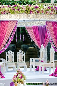 Love the fabric mandap colors and the mandap chairs