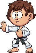 Cartoon kid practicing karate. Vector clip art illustration with simple gradients. Head and body on separate layers.