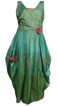~ Paul Poiret.   Green iridescent tissue silk with silver metallic couching and embroidered lace~