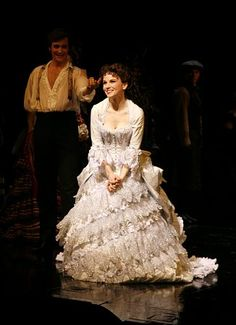 Jennifer Hope Wills as Christine (with Michael Shawn Lewis, who played Raoul, in the background) - Photo Flashback: Even More Past PHANTOM Anniversaries Broadway Costumes, Phantom Of The Opera, Costume Design, Past, Anniversary, Dresses, Fashion, Vestidos, Moda