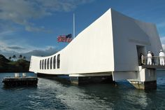 """The USS Arizona is the final resting place for many of the ship's 1,177 crewmen who lost their lives in the attack on Pearl Harbor 70 years ago. The 184-foot-long memorial, accessible only by boat, sits on the surface above the sunken vessel's midsection, rising at either end to signify the United States' ultimate victory. Its designer, Austrian-born Alfred Preis, fled the Nazi takeover of his homeland only to be imprisoned as an """"enemy alien"""" in Hawaii, not far from where his monument now…"""