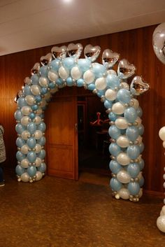 Classy wedding balloon arch in light blue, white and silver.