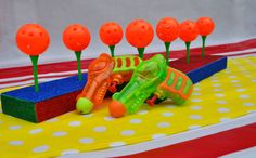 Sprayaway - great party game for a carnival or circus party - or just for fun! Use the squirt guns to shoot the balls down and see which team can win!