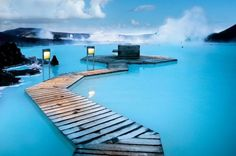 """The Blue Lagoon in Iceland is something travelers shouldn't miss. It also called """"The Land of Fire and Ice"""", because you're swimming in mud waters while it snows outside.  The geothermal spa, is one of the most visited attractions in Iceland. The steamy waters are part of a lava formation. The warm waters are rich in minerals like silica and sulphur and bathing in the Blue Lagoon is reputed to help some people suffering from skin diseases such as psoriasis. The water temperature averages 37–39°C"""
