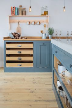 Solid timber Shaker doors, painted in Farrow & Ball's Down Pipe. I love the mix of grey and timber in this quality, bespoke kitchen. Shaker Kitchen, Kitchen And Bath, Kitchen Dining, Kitchen Cabinets, Kitchen Worktops, Base Cabinets, Plywood Kitchen, Kitchen Flooring, Kitchen Furniture