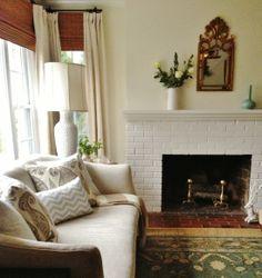 Living room with neutral linen sofa & great fabrics on pillows (Jasper paisley, LL Textiles chevron) Lauren Liess