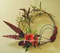 """""""Mahina"""" Mahina is Hawaiian for moonlight. This piece is mounted on a re-purposed barrel ring covered in spanish moss. The floral is attached with a bamboo armature and includes lilies, anthurium, millet and tropical foliage Flower Structure, Barrel Rings, Tropical, Cymbidium Orchids, Flower Bird, Hawaiian Flowers, Floral Design, Art Floral, Ikebana"""