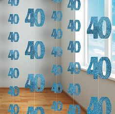 Our 40th Birthday Blue Hanging string Decoration is a perfect birthday party room decoration, stretching a full five feet in height. The shimmering metallic blue and silver finish means that this decoration is really eye catching when hung from a ceiling.