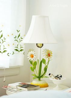 Love this daisy lamp and matching curtains.  Via A Sort Of Fairytale