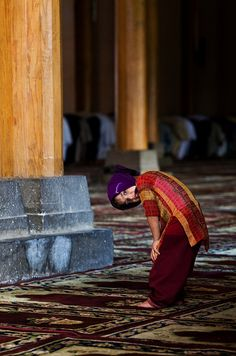 Kashmiri Muslim girl poses for photograph as she prays at the Jama Masjid in Srinagar.