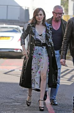 Happy: Lily Collins looked in good spirits as she arrived at the ITV studios in London on Tuesday