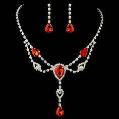 """This sparkling red rhinestone surrounded with clear cut shining stones is the perfect touch of color and glam! With dangle earrings to match this bridal set is the complete look for any wedding! 17"""" ("""